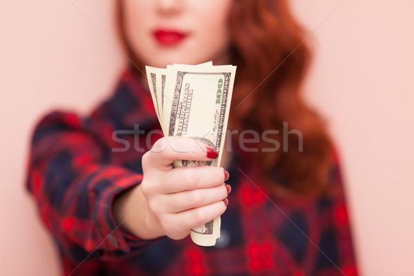 Mädchen Geld überrascht Rotschopf rot Kleid Stock foto © Massonforstock