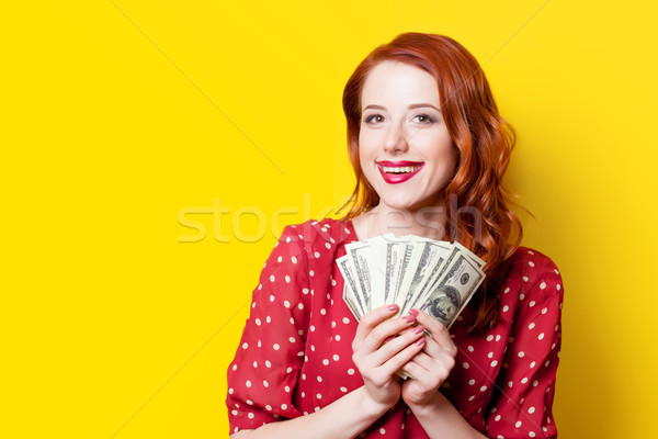 girl in red dress with money Stock photo © Massonforstock
