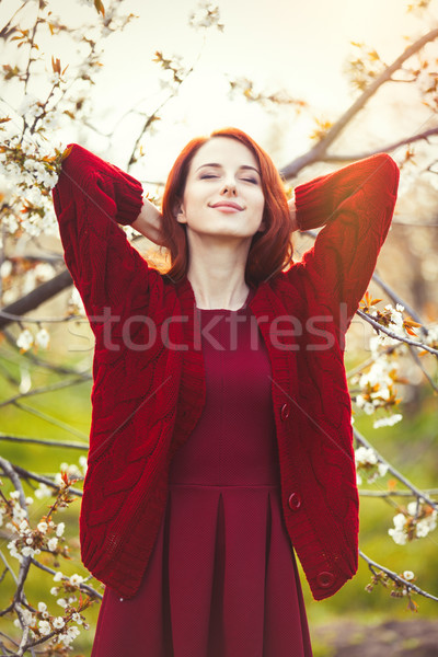 portrait of a young woman near blooming tree Stock photo © Massonforstock