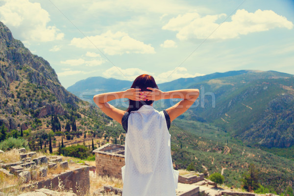 beautiful young woman standing in front of splendid mountain and Stock photo © Massonforstock