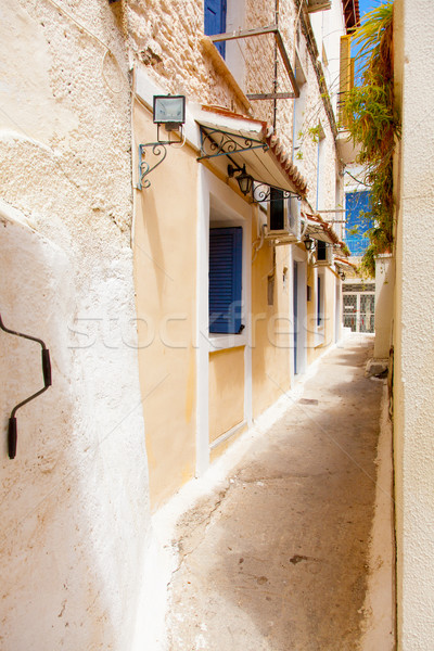 photo of one of cozy and little streets full plants in sunny and Stock photo © Massonforstock