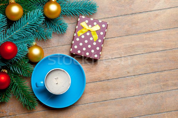 fir tree branches, cup of coffee, gift and colorful baubles on t Stock photo © Massonforstock