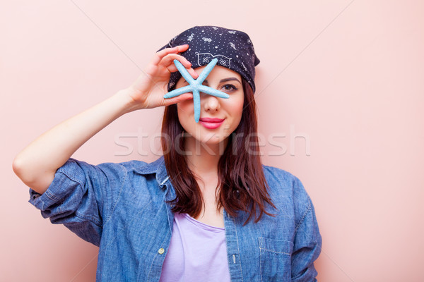 portrait of a young woman with starfish Stock photo © Massonforstock