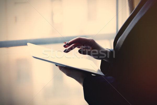 young caucasian female hands holding a tablet and typing text ne Stock photo © Massonforstock