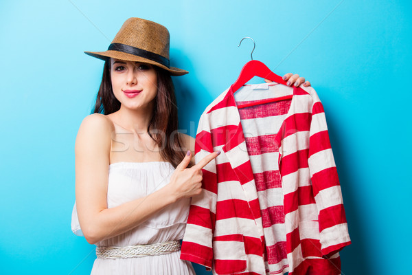 beautiful young woman with striped jacket on hanger standing in  Stock photo © Massonforstock