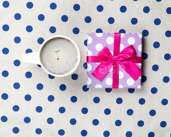 photo of cup of coffee and cute gift on the wonderful white dott Stock photo © Massonforstock