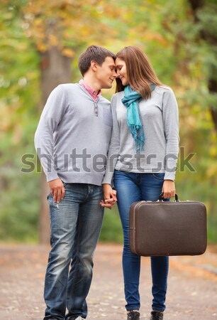 photo of cute couple sitting on the bench on the wonderful autum Stock photo © Massonforstock