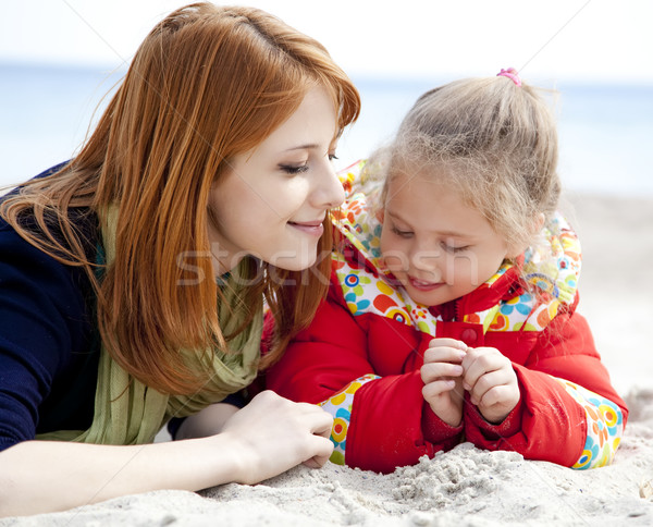 Two sisters at the beach in spring day. Stock photo © Massonforstock