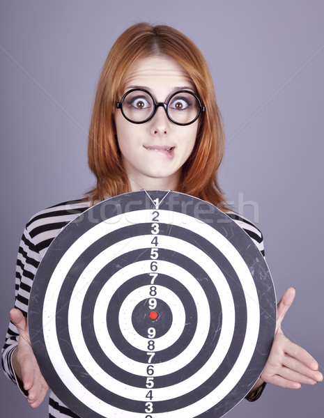 Red-haired girl with dartboard. Stock photo © Massonforstock