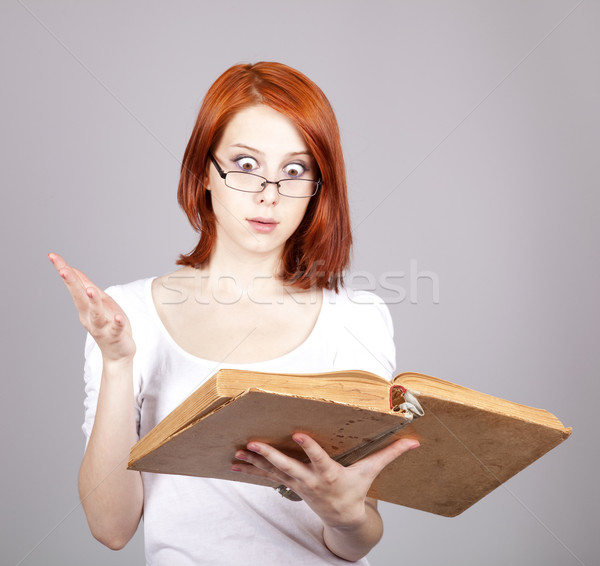 Red-haired businesswoman keep book in hand. Stock photo © Massonforstock