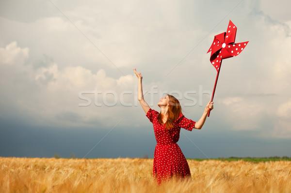 赤毛 少女 おもちゃ 風力タービン 雲 女性 ストックフォト © Massonforstock