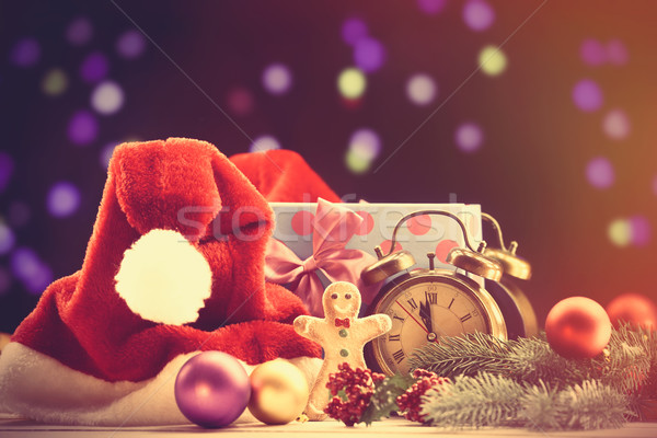 Santas hat and gifts Stock photo © Massonforstock