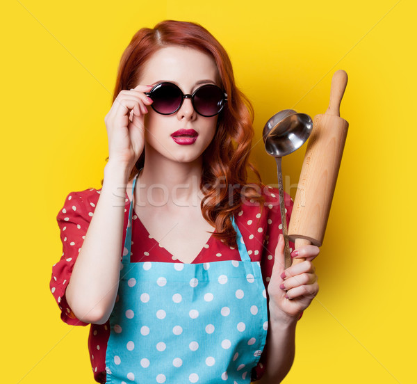 girl in red dress with plunger Stock photo © Massonforstock