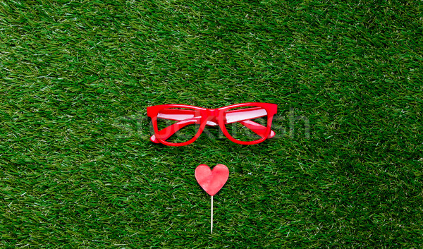 Heart shape symbol and red styled glasses Stock photo © Massonforstock