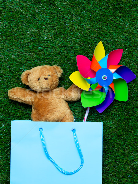 teddy bear with wind toy in shopping bag Stock photo © Massonforstock