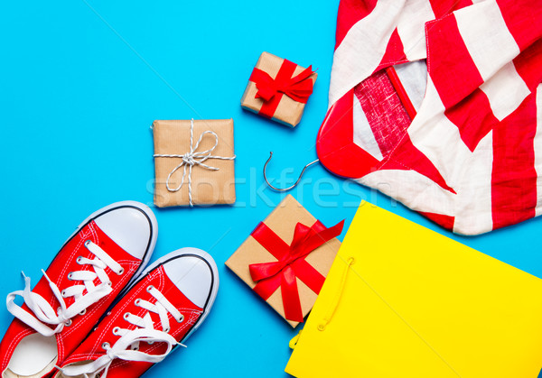 big red gumshoes, cool shopping bag, striped jacket on hanger an Stock photo © Massonforstock