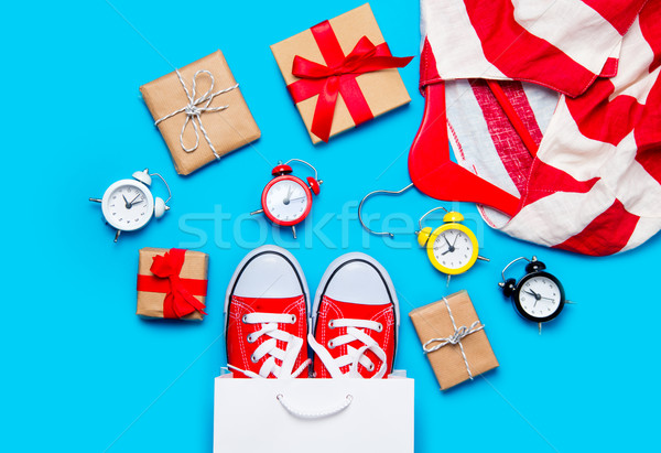 big red gumshoes in cool shopping bag, alarm clocks and striped  Stock photo © Massonforstock