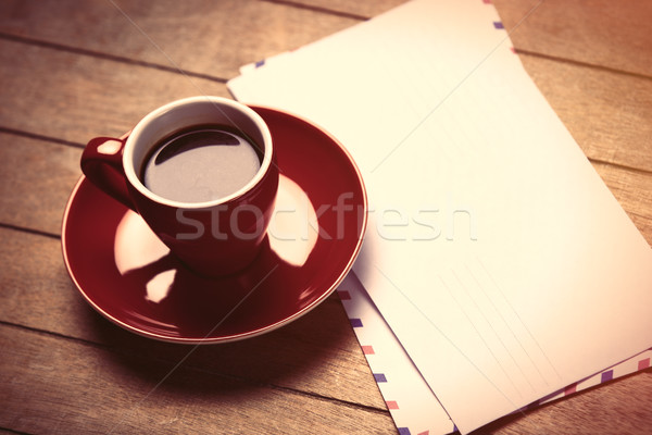 photo of red cup of coffee and several envelopes on the wonderfu Stock photo © Massonforstock