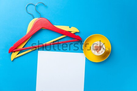 photo of empty sheet of paper, cup of coffee and hangers on the  Stock photo © Massonforstock