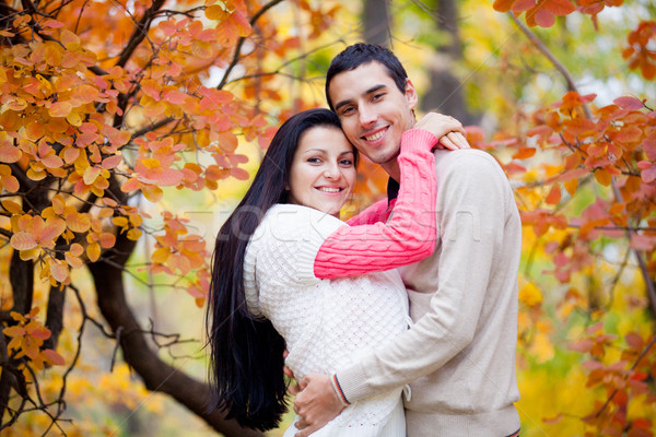 photo of cute couple hugging on the wonderful yellow trees backg Stock photo © Massonforstock