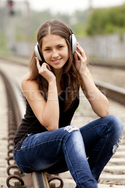 Teen Girl With Headphones At Railways. Stock Photo