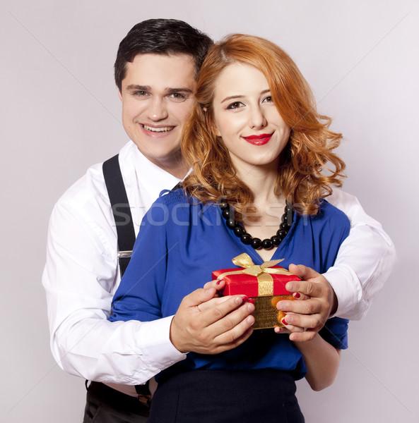 American couple with girt Stock photo © Massonforstock