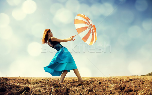 Menina guarda-chuva ventoso campo mulheres Foto stock © Massonforstock