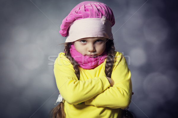 Stock photo: Close-up portrait of adorable sad child girl wearing pink knitte