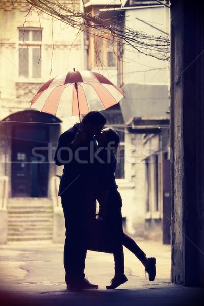 Couple baiser patio fille rue urbaine Photo stock © Massonforstock