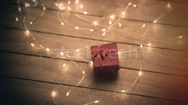 beautiful cute gift with red ribbon and garland lying on the won Stock photo © Massonforstock