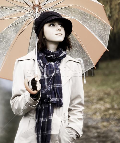 少女 傘 公園 雨の 日 写真 ストックフォト © Massonforstock