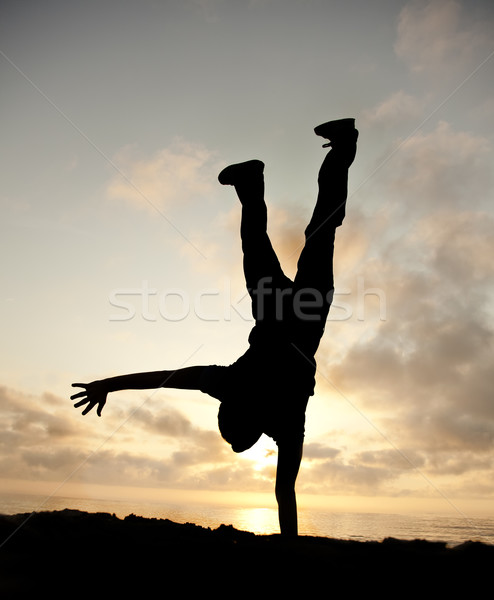 Stock photo: Cartwheel on the sunset