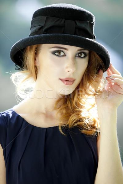 Fashion redhead girl in cap. Stock photo © Massonforstock