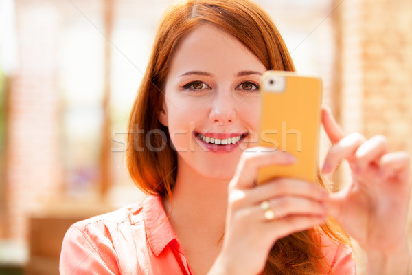 woman using mobile phone Stock photo © Massonforstock