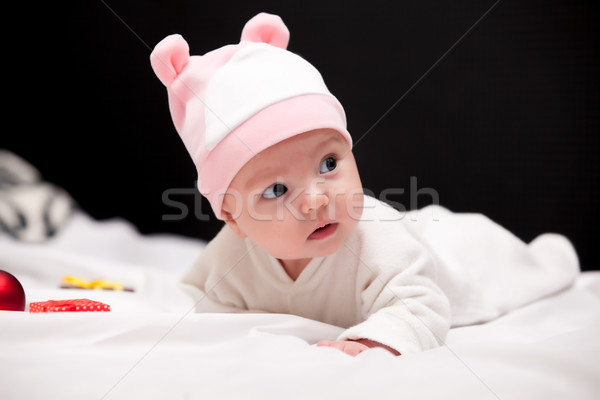 beautiful cute baby in hat near gifts and bauble lying on the wh Stock photo © Massonforstock