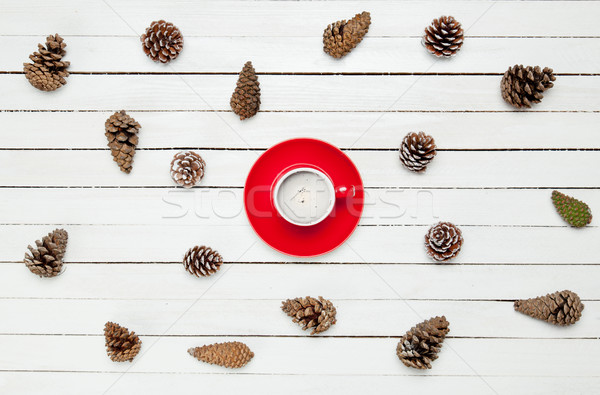 photo of red cup of coffee near dried beautiful cones on the won Stock photo © Massonforstock
