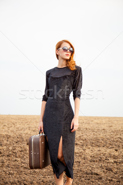 photo of beautiful young woman with sutcase on the wonderful fie Stock photo © Massonforstock