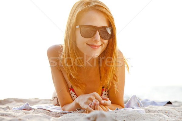 Stock photo: Red-head girl at the beach in sunrise.