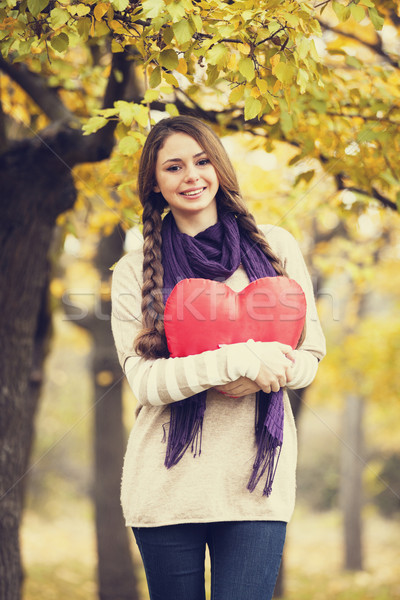 Redhead girl with toy heart at autumn park. Stock fotó © Massonforstock