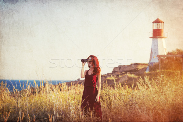 Fille phare jeunes herbe femmes Photo stock © Massonforstock