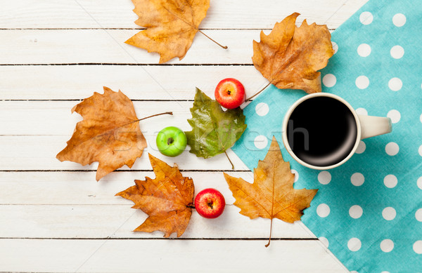 Cup of coffee and leafs with apples Stock photo © Massonforstock