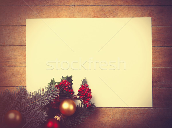 White papaer and christmas toys with fir-tree branch Stock photo © Massonforstock