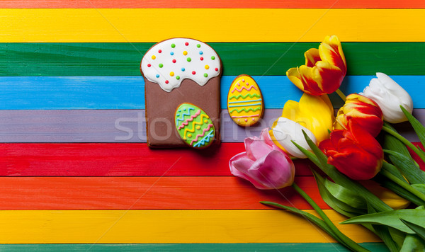 bunch of tulips, cake and eggs lying on the table Stock photo © Massonforstock