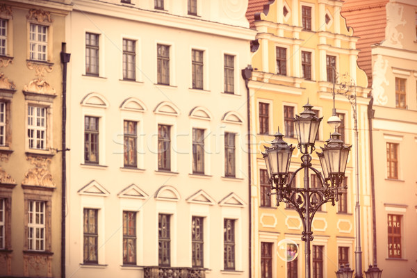 photo of beautiful old buildings and vintage lamp post in Wrocla Stock photo © Massonforstock