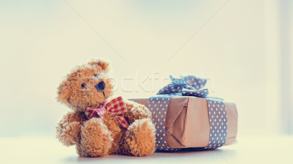 cute teddy bear and beautiful gift on the wonderful white backgr Stock photo © Massonforstock