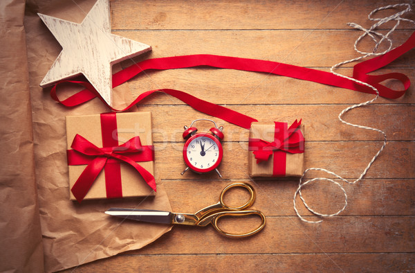 cute gifts, star shaped toy, alarm clock and things for wrapping Stock photo © Massonforstock