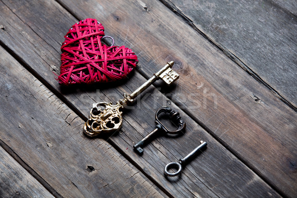 beautiful heart shaped toy and different keys on the wonderful b Stock photo © Massonforstock