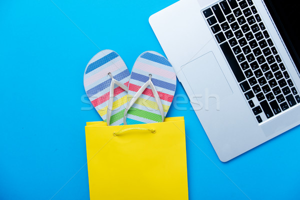 colorful sandals in shopping bag and cool laptop on the wonderfu Stock photo © Massonforstock