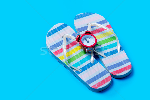 colorful sandals and cute small alarm clock on the wonderful blu Stock photo © Massonforstock