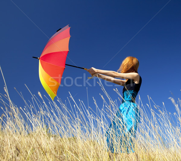 Fille parapluie venteux herbe prairie Photo stock © Massonforstock